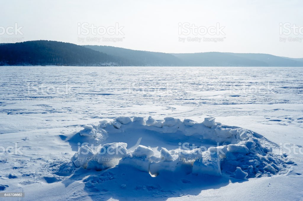 Hole for winter fishing on the lake stock photo