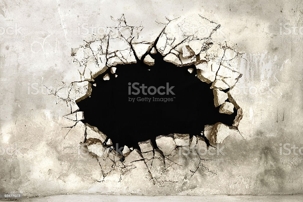 Hole in a mortar wall stock photo