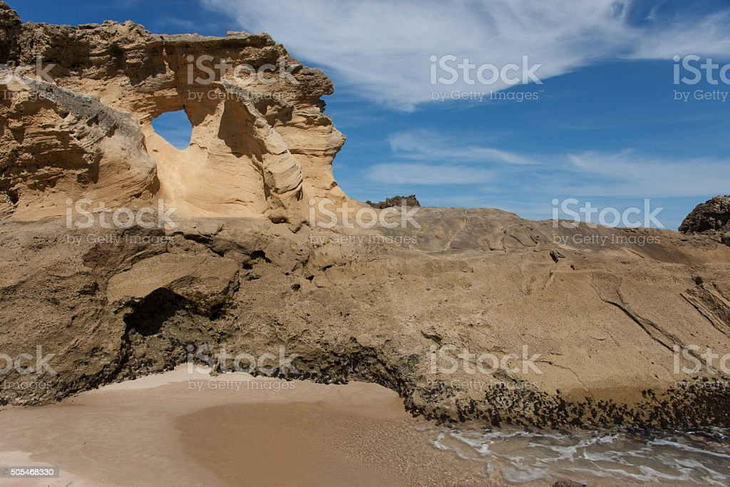 Hole in a petrified dune on a South African beach stock photo