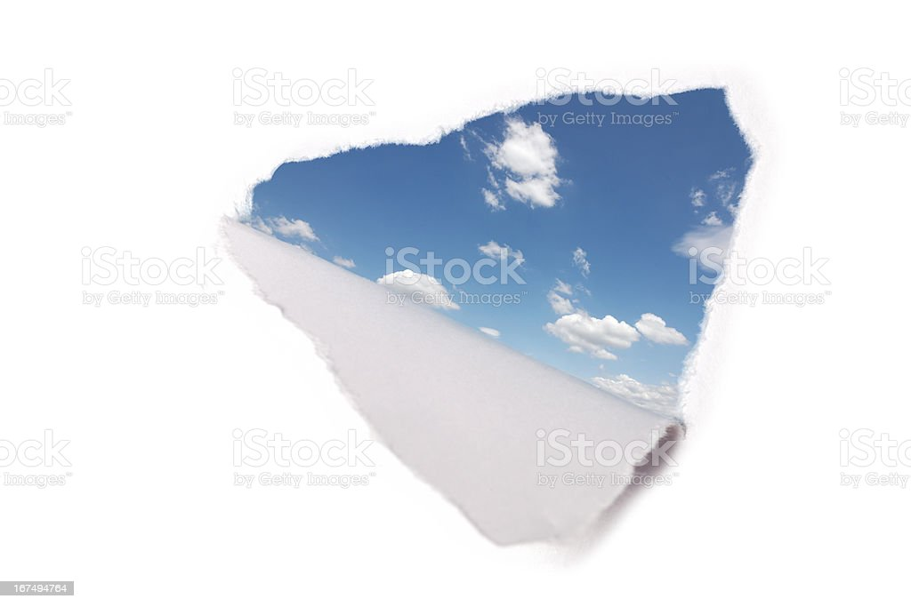 hole in paper with view to sky stock photo