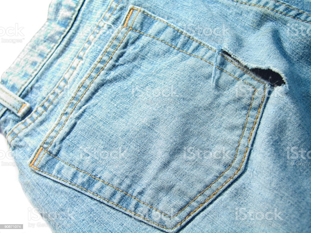Hole in pocket of jeans royalty-free stock photo