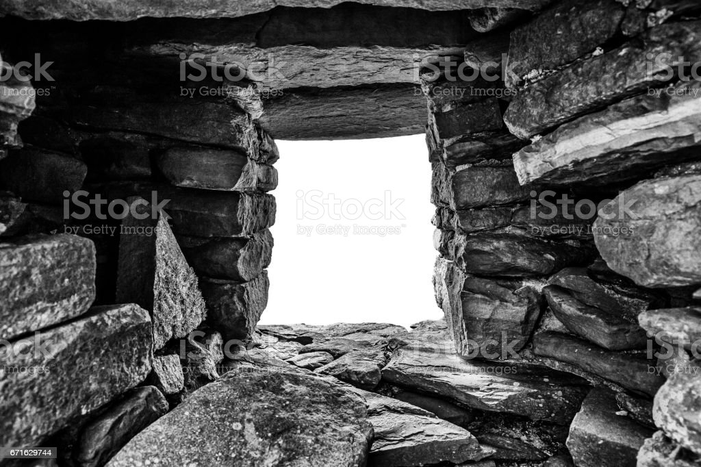 Hole in rock tunnel with white copy space stock photo