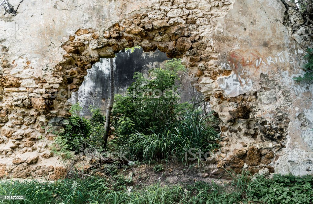 Hole in Stone Wall stock photo