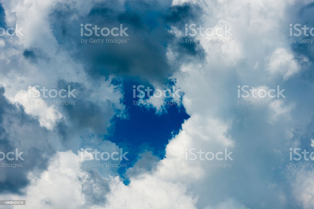 hole in the clouds stock photo