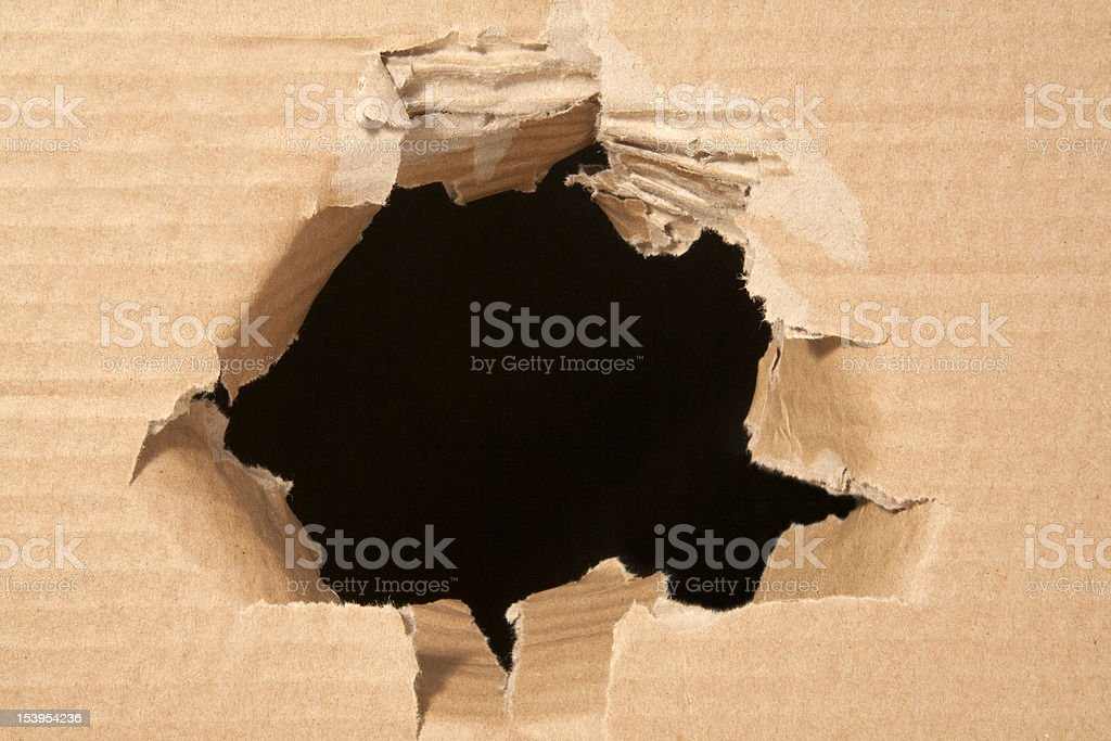 hole in the paper royalty-free stock photo
