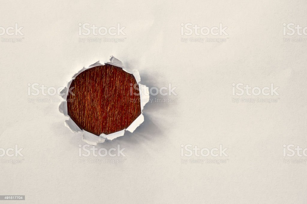 Hole in the paper with torn stock photo