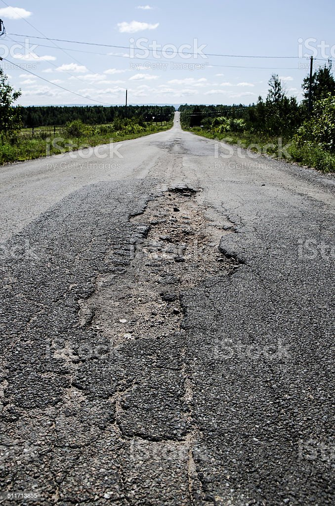 Hole in the road stock photo