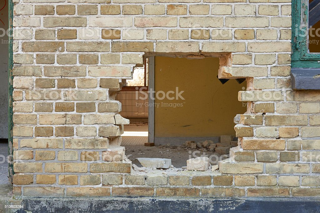 old house with a large hole in the wall