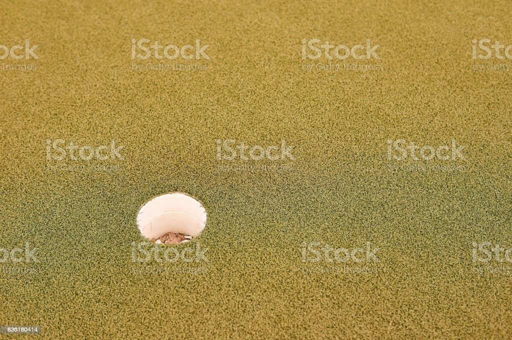 Hole on golf terrain. stock photo