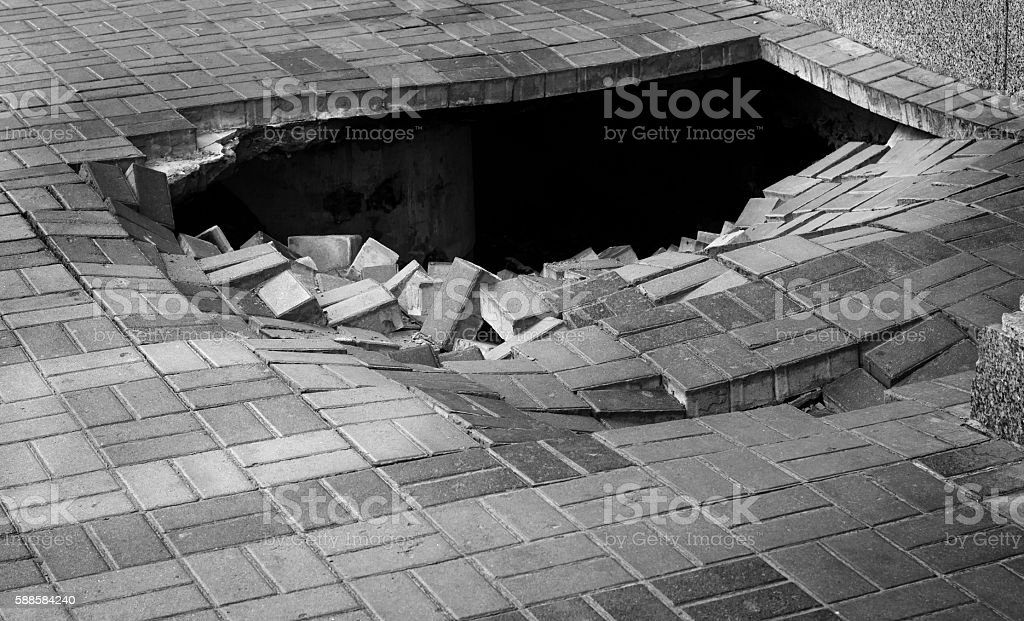 Hole on the street stock photo