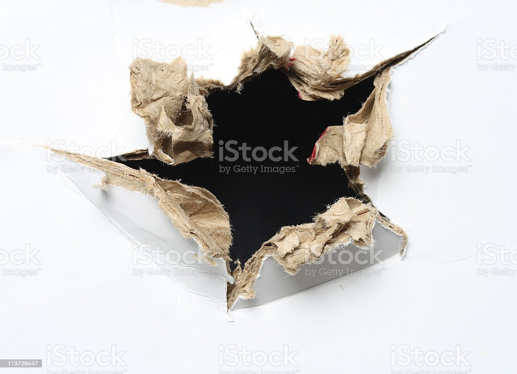 Hole poked through white carton royalty-free stock photo