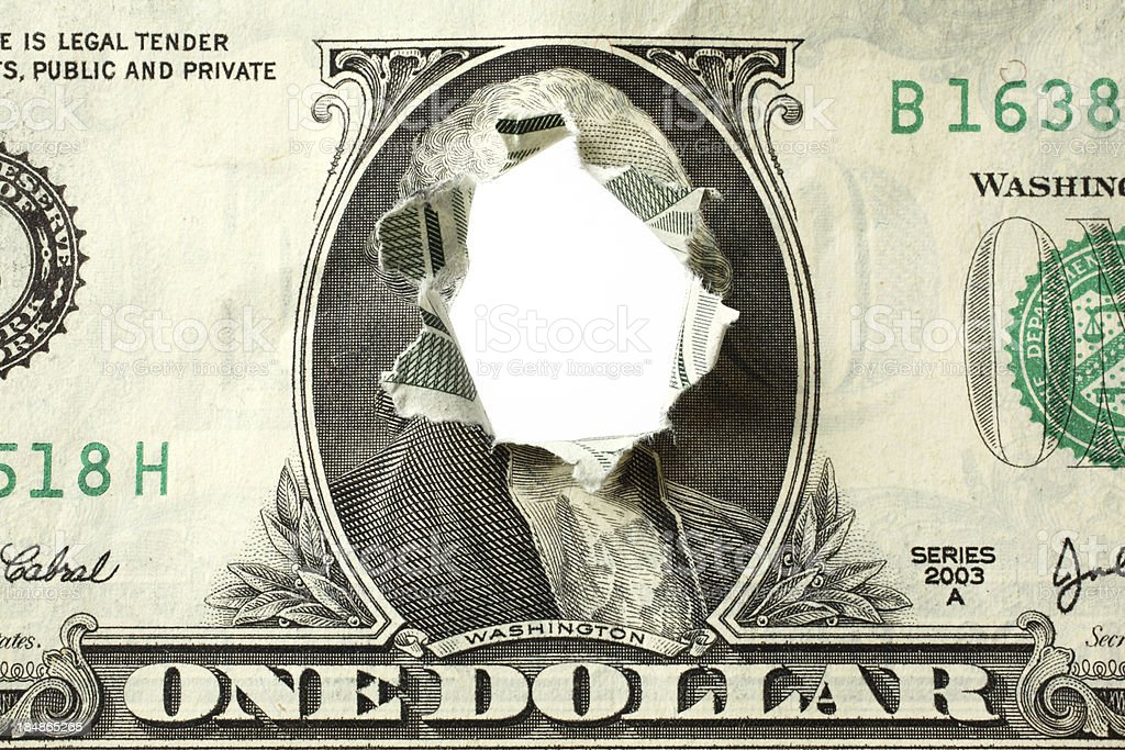 Hole Punched Through Dollar Bill royalty-free stock photo