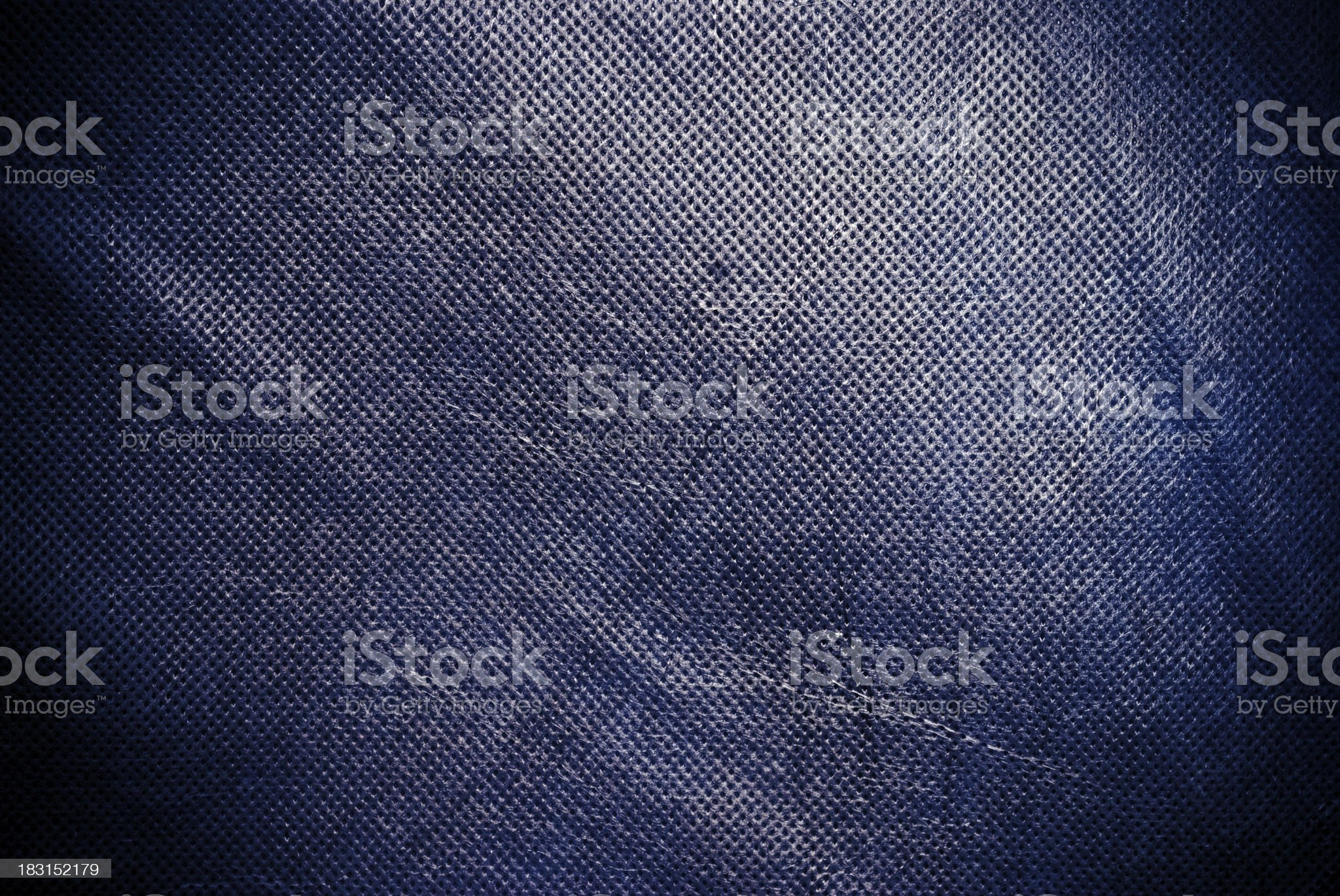 Holed and creased navy blue canvas background or texture royalty-free stock photo