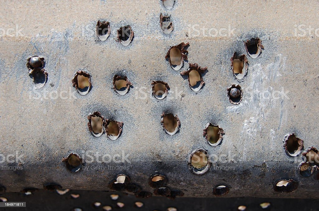 Holes bored through metal sheet royalty-free stock photo