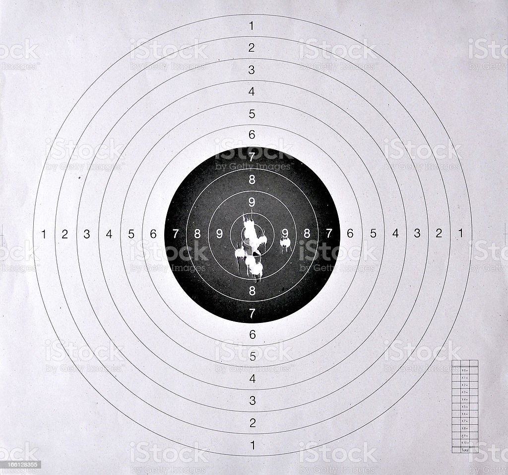 Holes in a shooting  target stock photo
