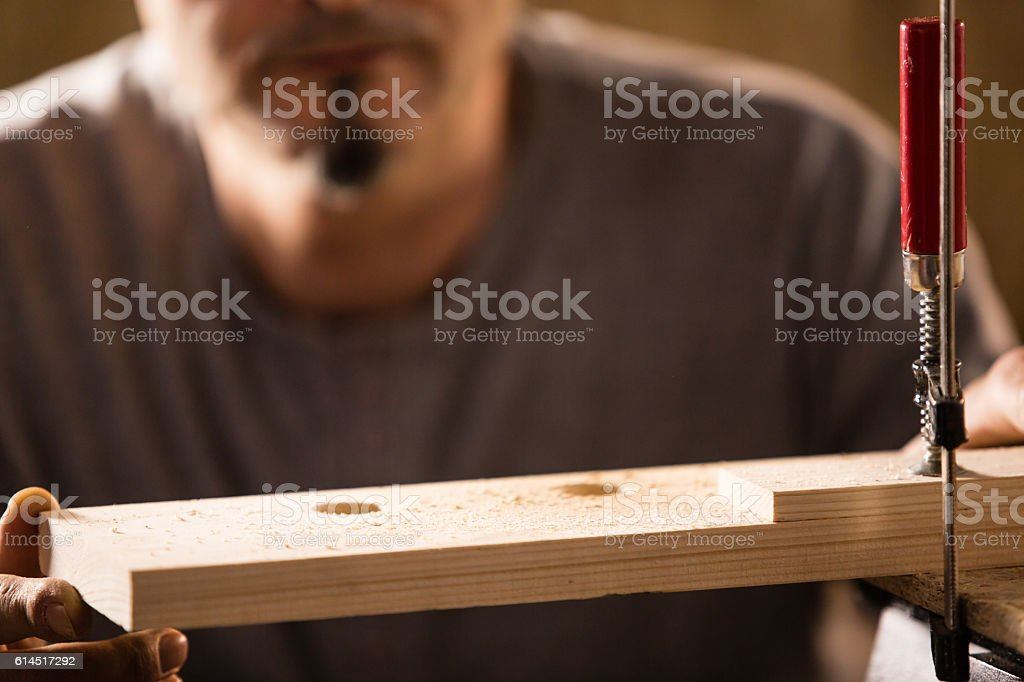 Holes in wood block stock photo