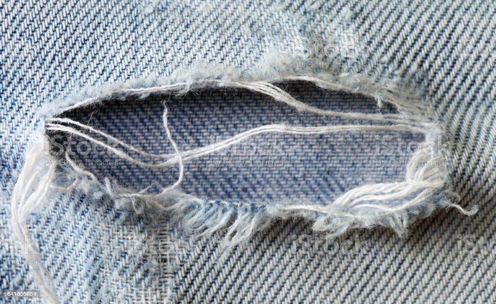 Holey jeans stock photo
