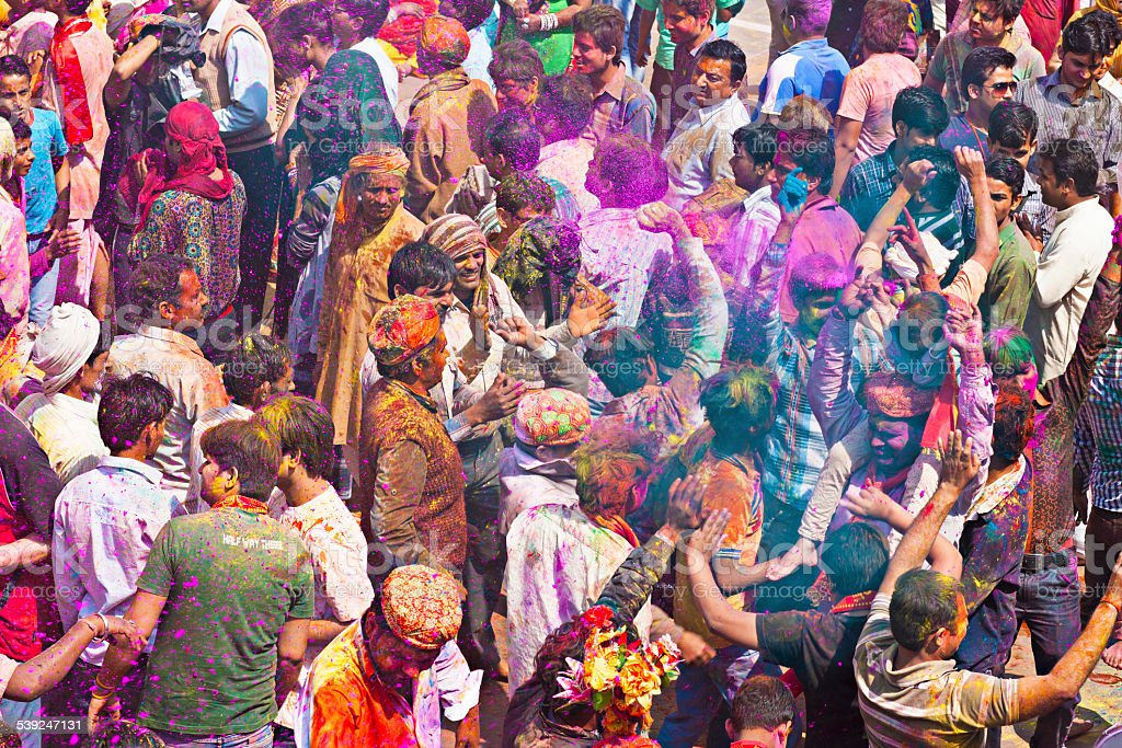 Indian people dancing in the Holi festivities.