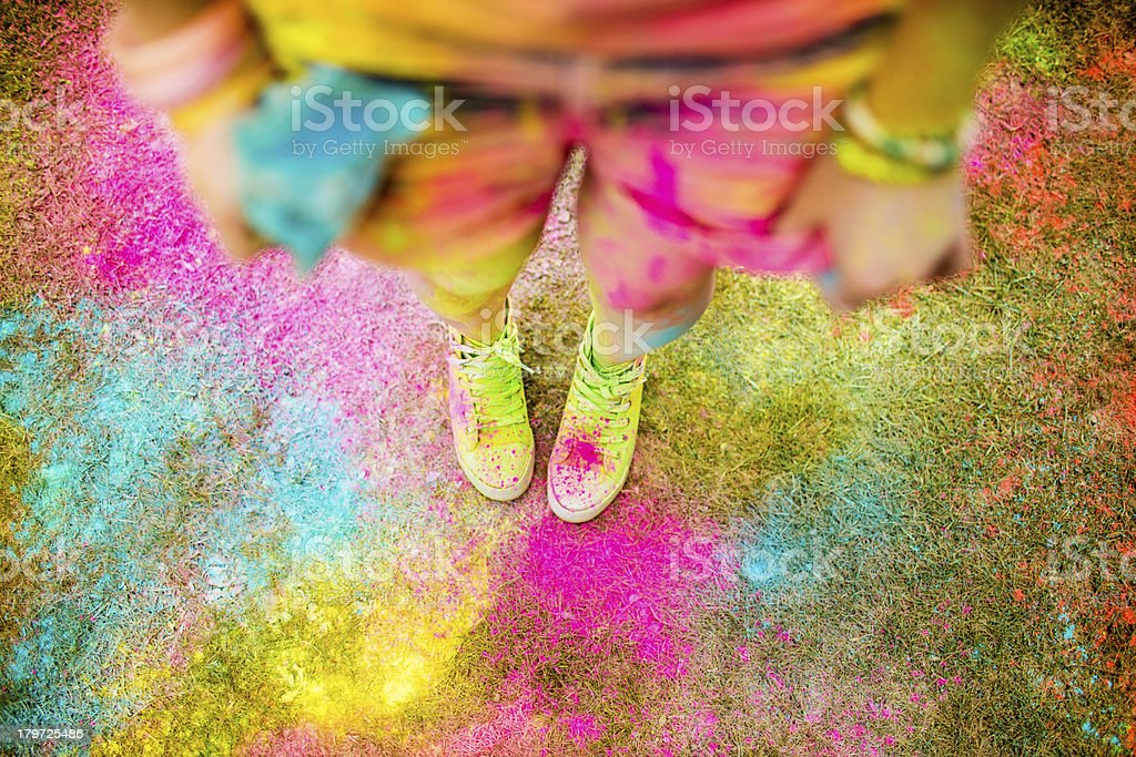 Holi powder festival concept with hipster girl stock photo