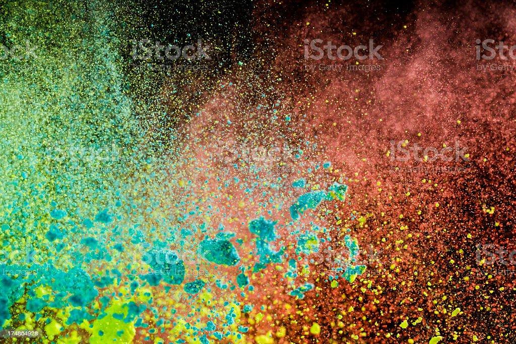Holi powder (green, yellow amd red) stock photo