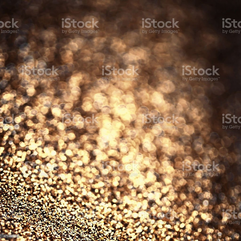 Holiday abstract glitter background with blinking lights and gold stock photo