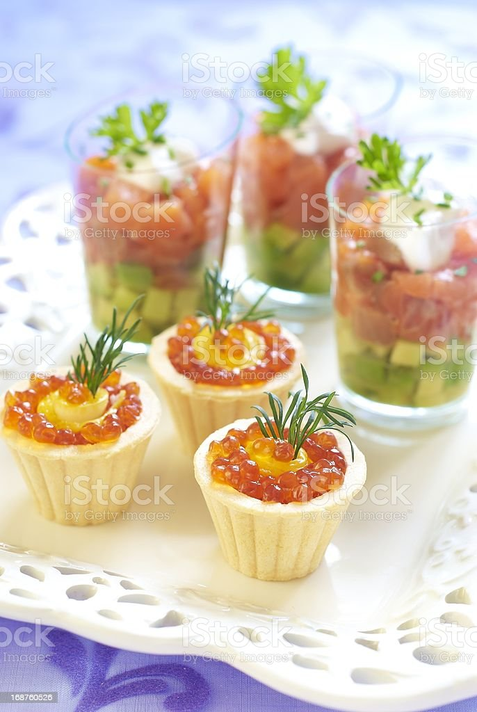 Holiday appetizers with salmon and red caviar royalty-free stock photo