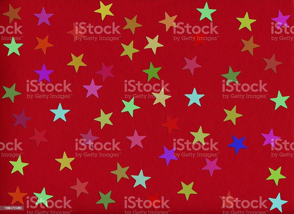 holiday background. confetti in shape of star on red royalty-free stock photo