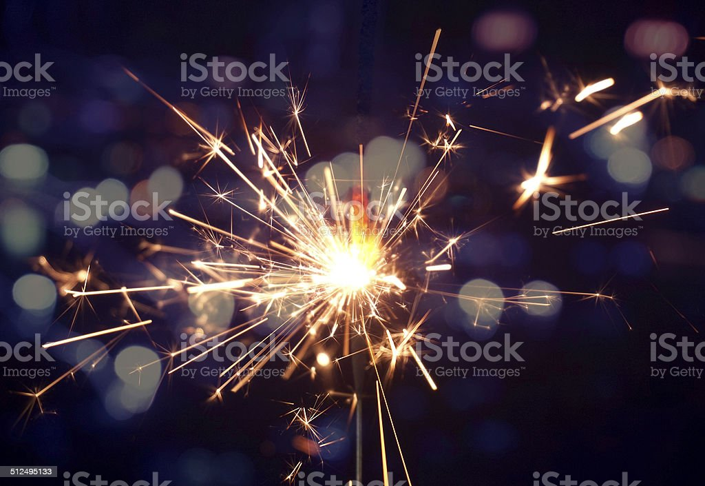 holiday background with a sparkler stock photo