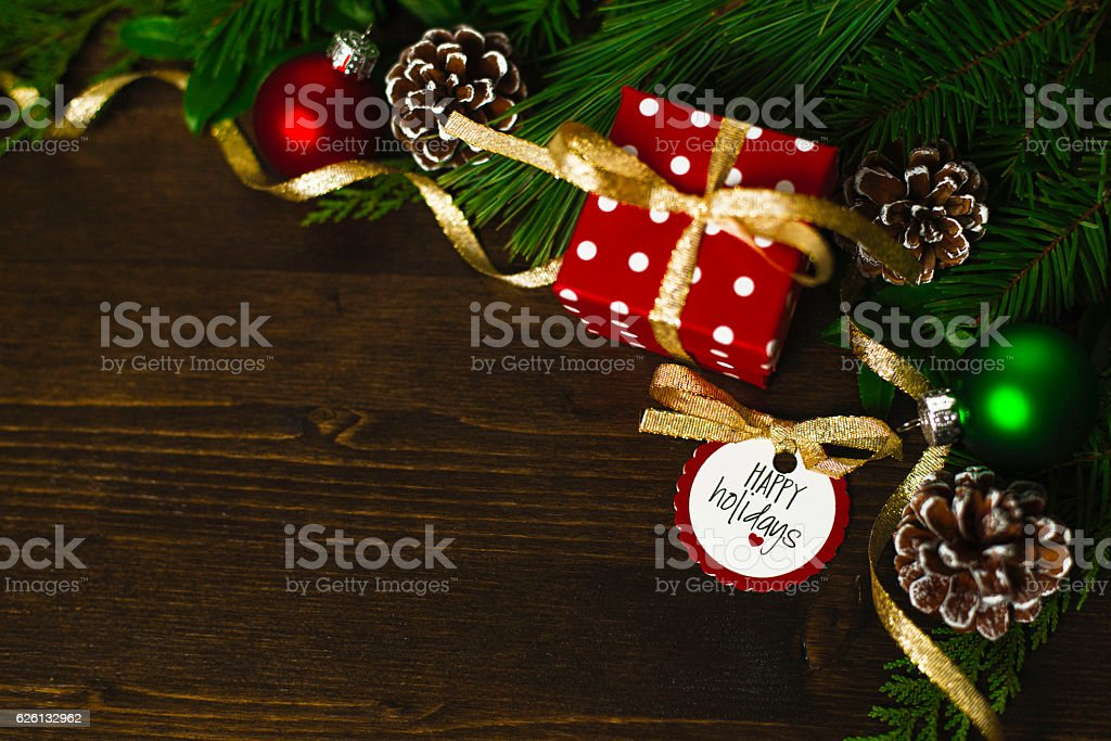 Holiday background with gift, real greenery and message stock photo