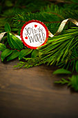 Holiday background with real greenery, ribbon and Christmas message