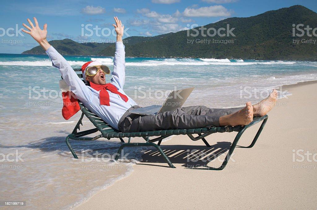 Holiday Businessman Celebrates on Beach Chair royalty-free stock photo