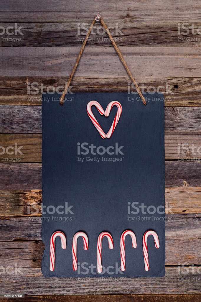 Holiday candy cane heart shape and fence stock photo