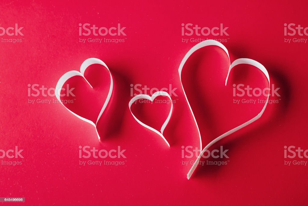 Holiday Card. Heart for Valentines day. White hearts on a red ba stock photo
