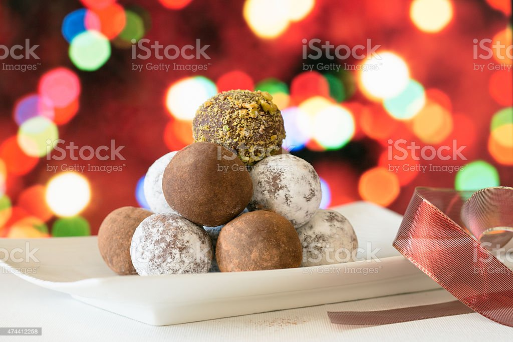 Holiday Chocolate Truffles at Christmas Tree stock photo