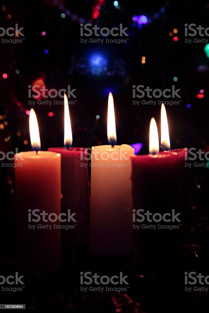 Holiday: Christmas Advent Wreath Candles with lights in background stock photo