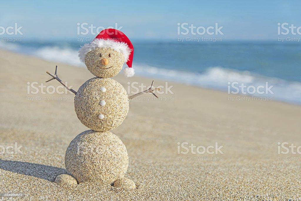 Holiday Christmas concept with a happy sandy snowman stock photo