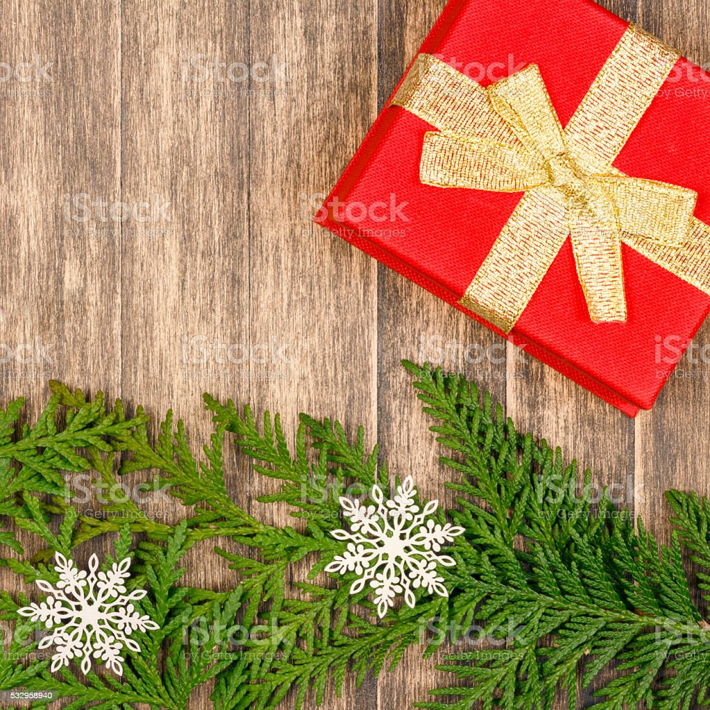 Holiday christmas gift on rustic wood table background stock photo