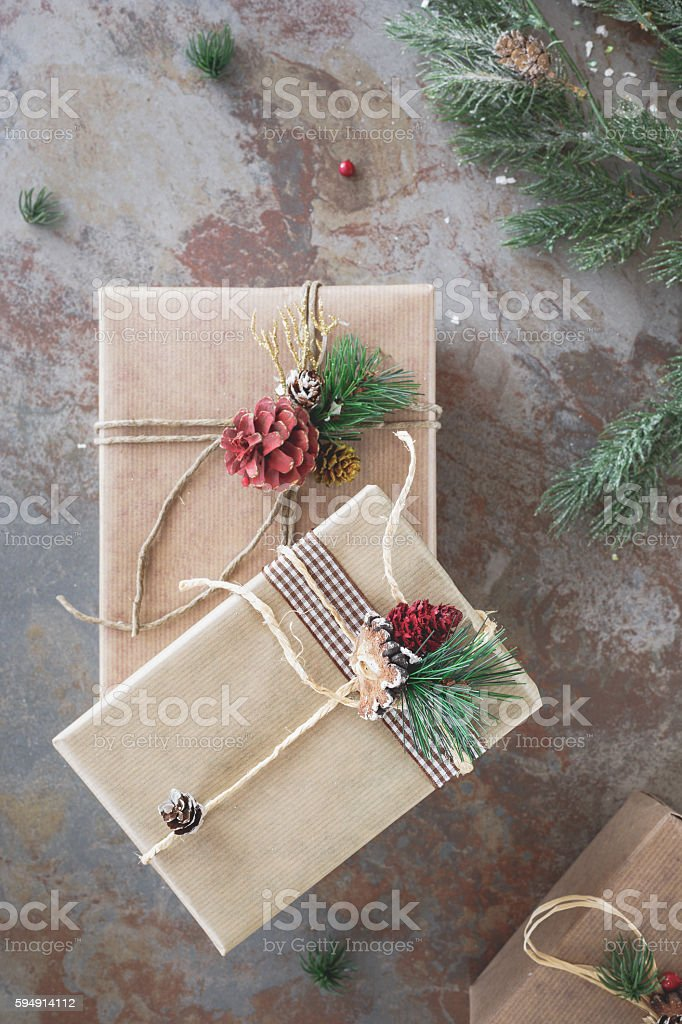 Still life of homemade wrapped Christmas present. Top view, vintage...