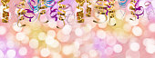 Holiday colorful panoramic background with ribbon and  blurred bokeh lights