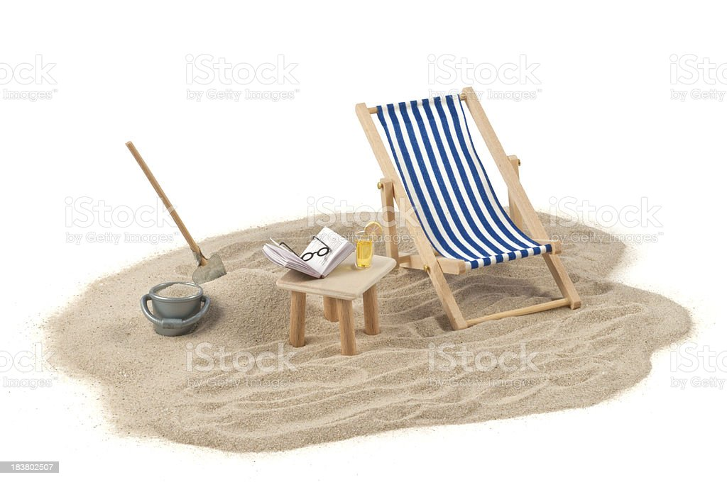 Holiday concept -  deckchair, sand and drink royalty-free stock photo