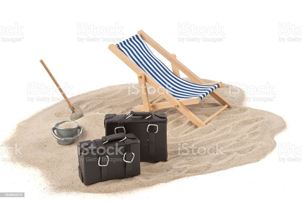 Holiday concept -  deckchair, sand, bags and drink stock photo