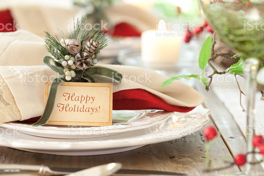 Holiday Dining Table with Place Card and Happy Holidays stock photo
