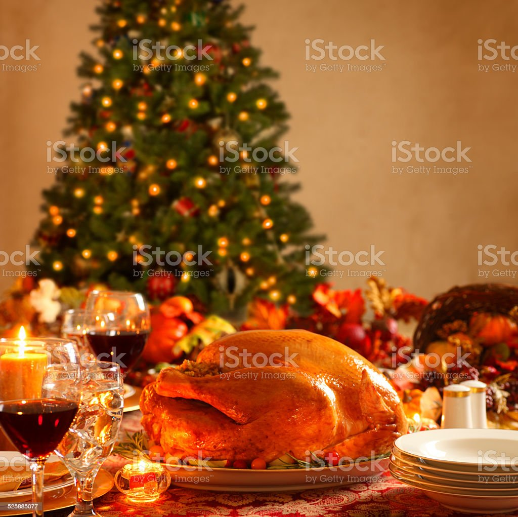 Holiday Dinner In Front of Christmas Tree stock photo