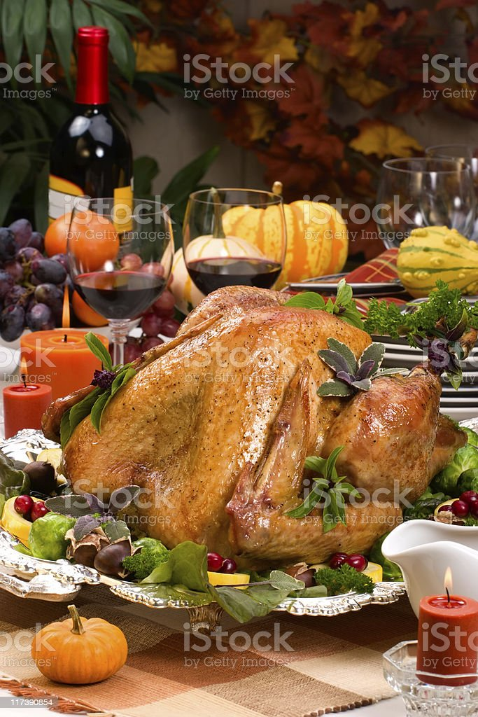 Holiday dinner table with turkey and red wine royalty-free stock photo