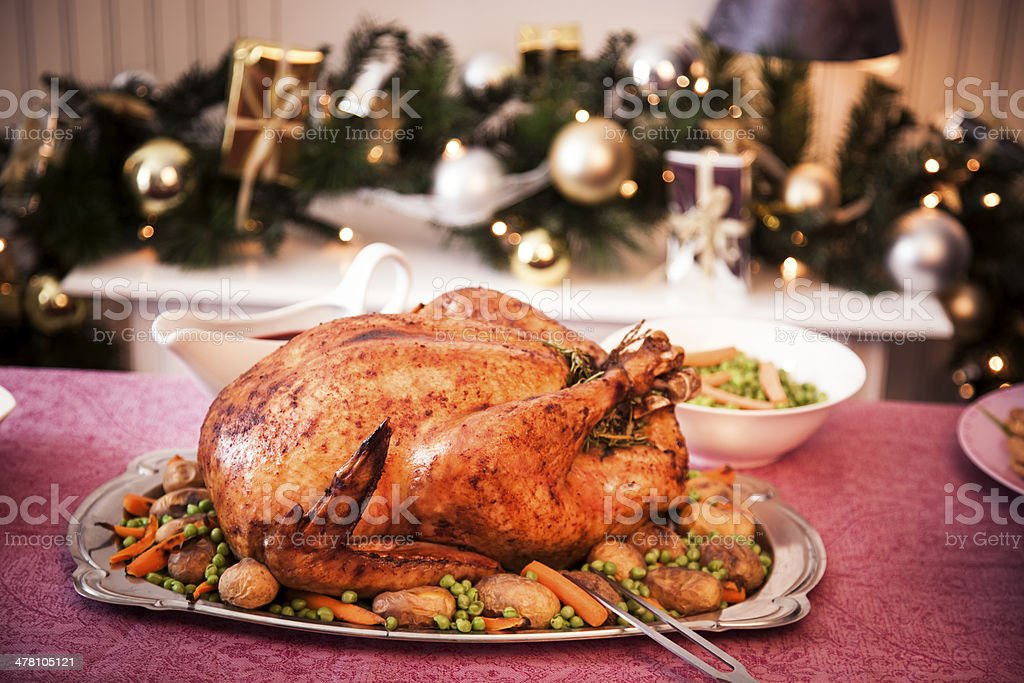 Holiday Dinner with Stuffed Turkey and Side Dishes royalty-free stock photo