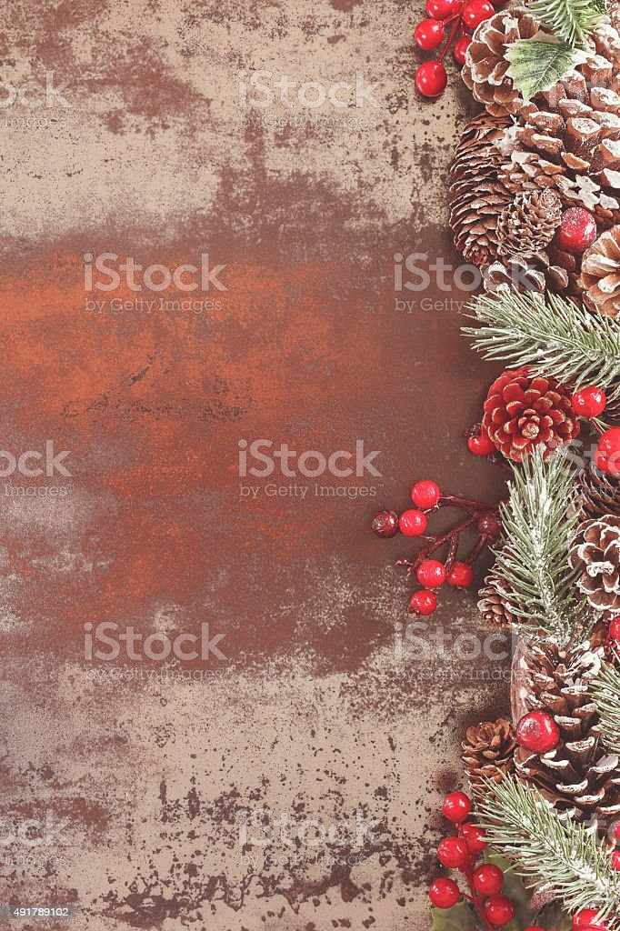 Holiday frame with pine cones stock photo