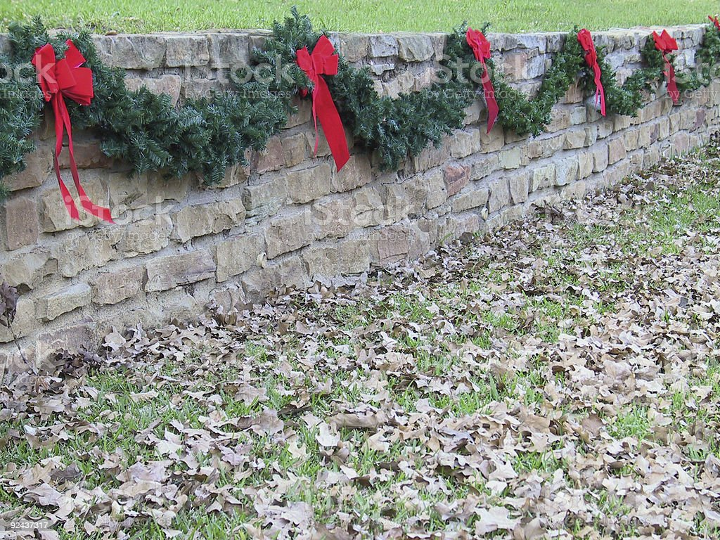 Holiday Garland on Stone Wall royalty-free stock photo
