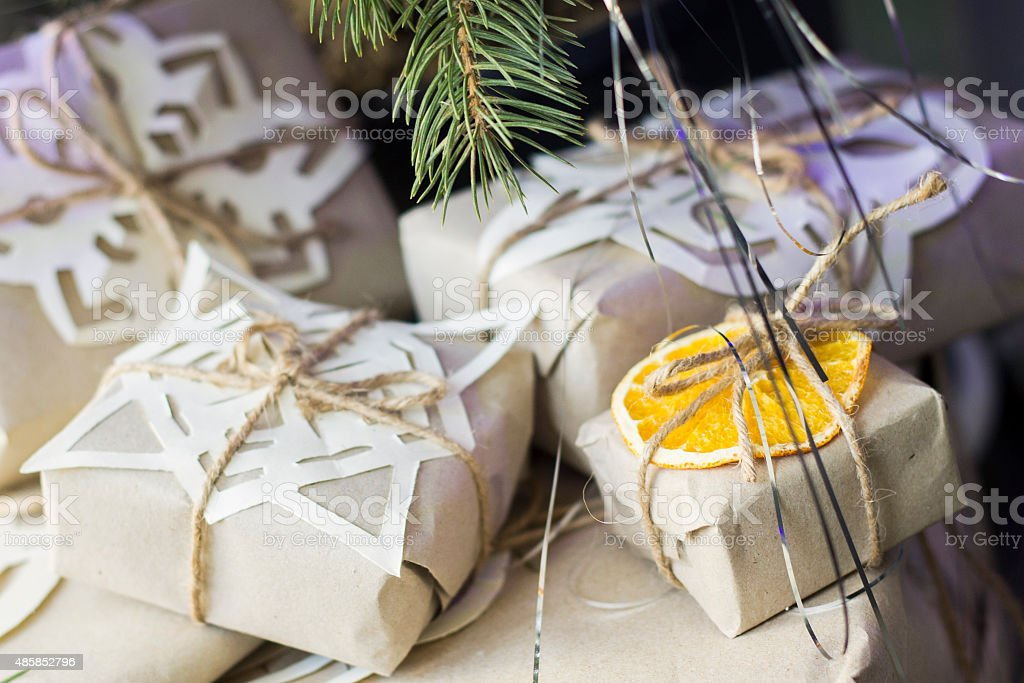Holiday gift wrapped in eco-paper with twine ribbon stock photo