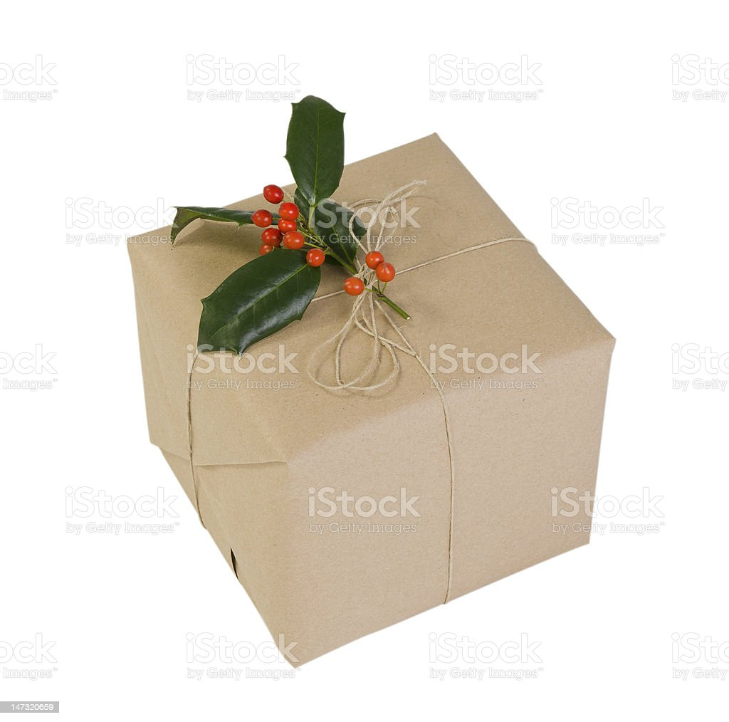 Holiday gift wrapped in kraft paper royalty-free stock photo