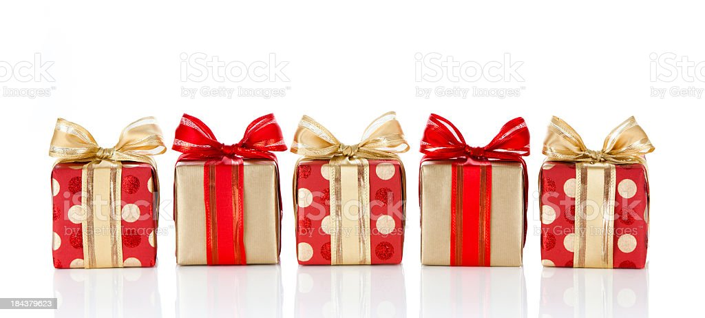 Holiday gifts wrapped in red and gold paper stock photo